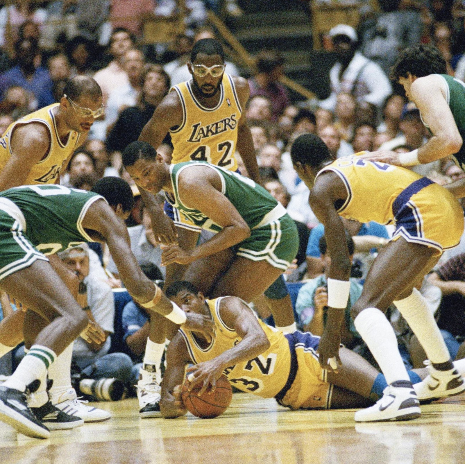 02d7b81cc36 Magic Johnson (on floor) and Kareem Abdul-Jabbar, left, tangle with the  Celtics in the 1987 NBA Finals. Much like today's Warriors, the Lakers  collected ...