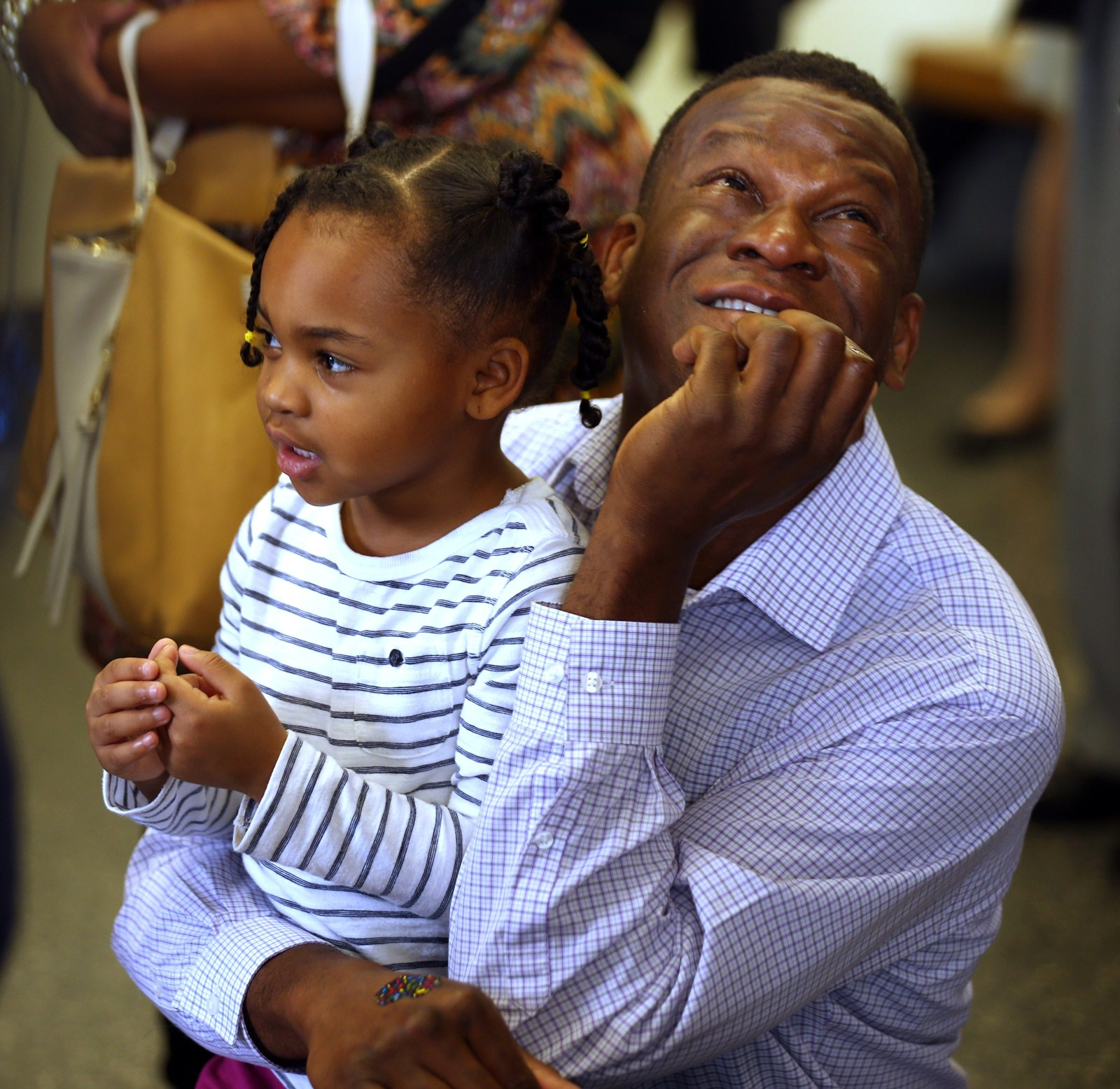 Roger Farquharson Holds Daughter Asia As They Listen To Speakers During A  National Adoption Day Ceremony Friday At Daley Center ()