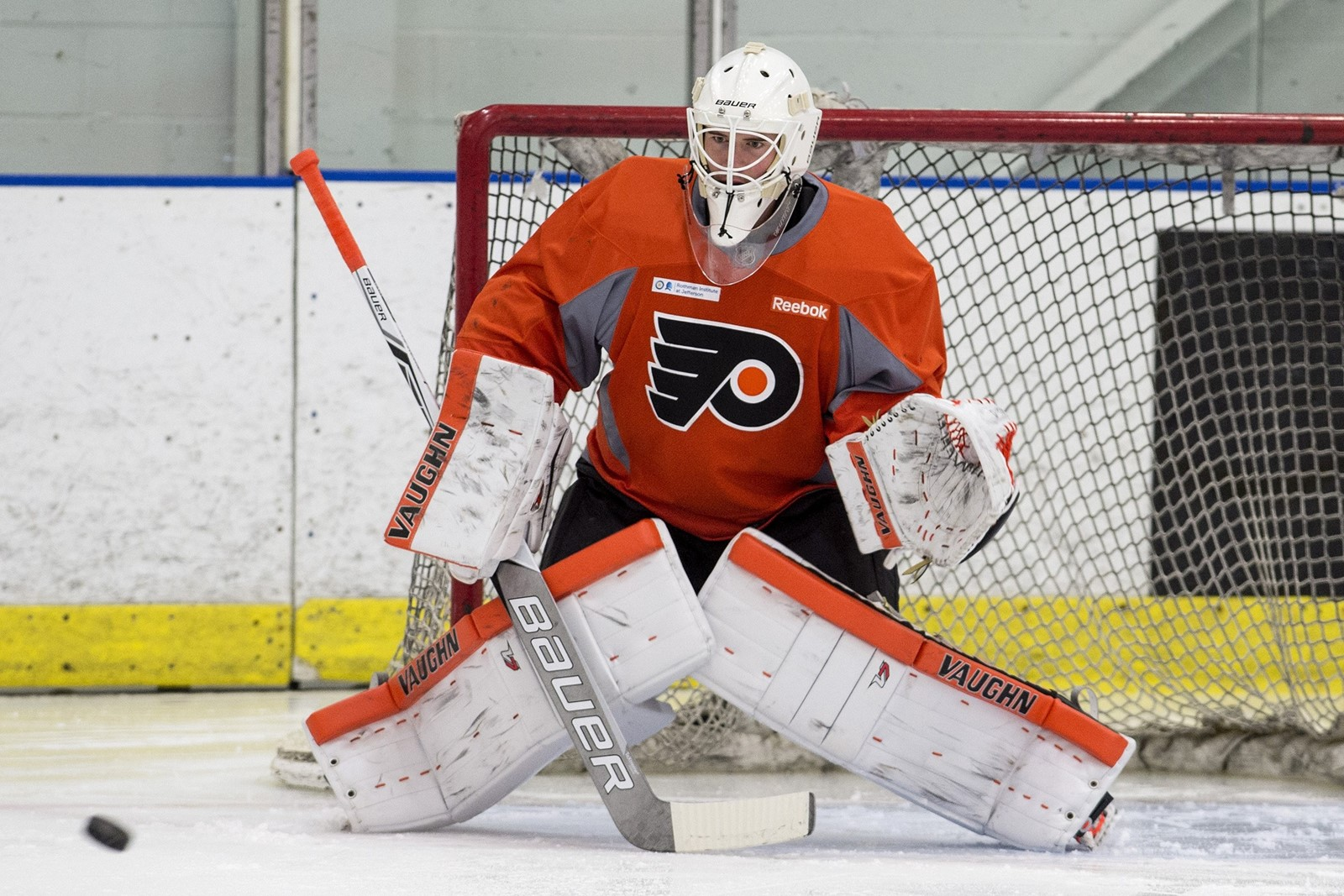 55bed7545a4 Goaltender Carter Hart keeps his eyes on the puck during practice at a  Flyers development camp in Voorhees, Pa., in 2017. Hart helped Canada win  the World ...