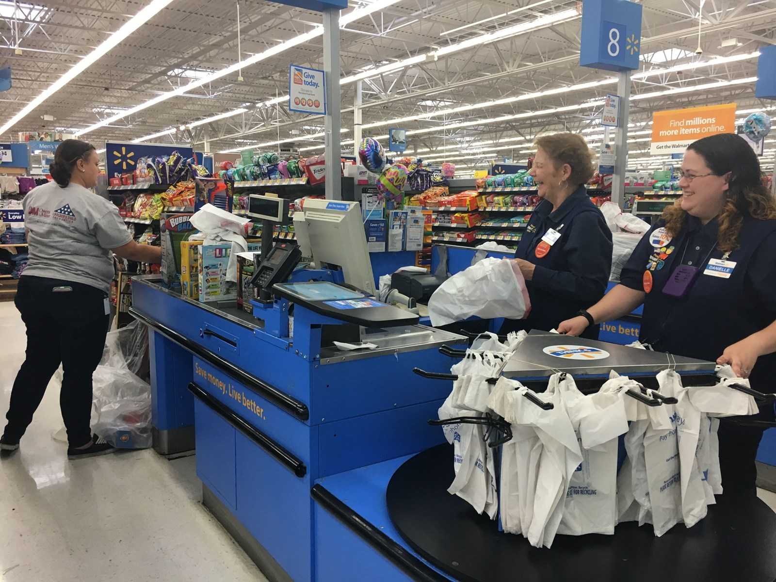 Walmart Employees Kerry Hathaway And Danielle Timon Help Ring Up The Presents For A Soldiers Child Friday In Hanover Organization Donates Birthday