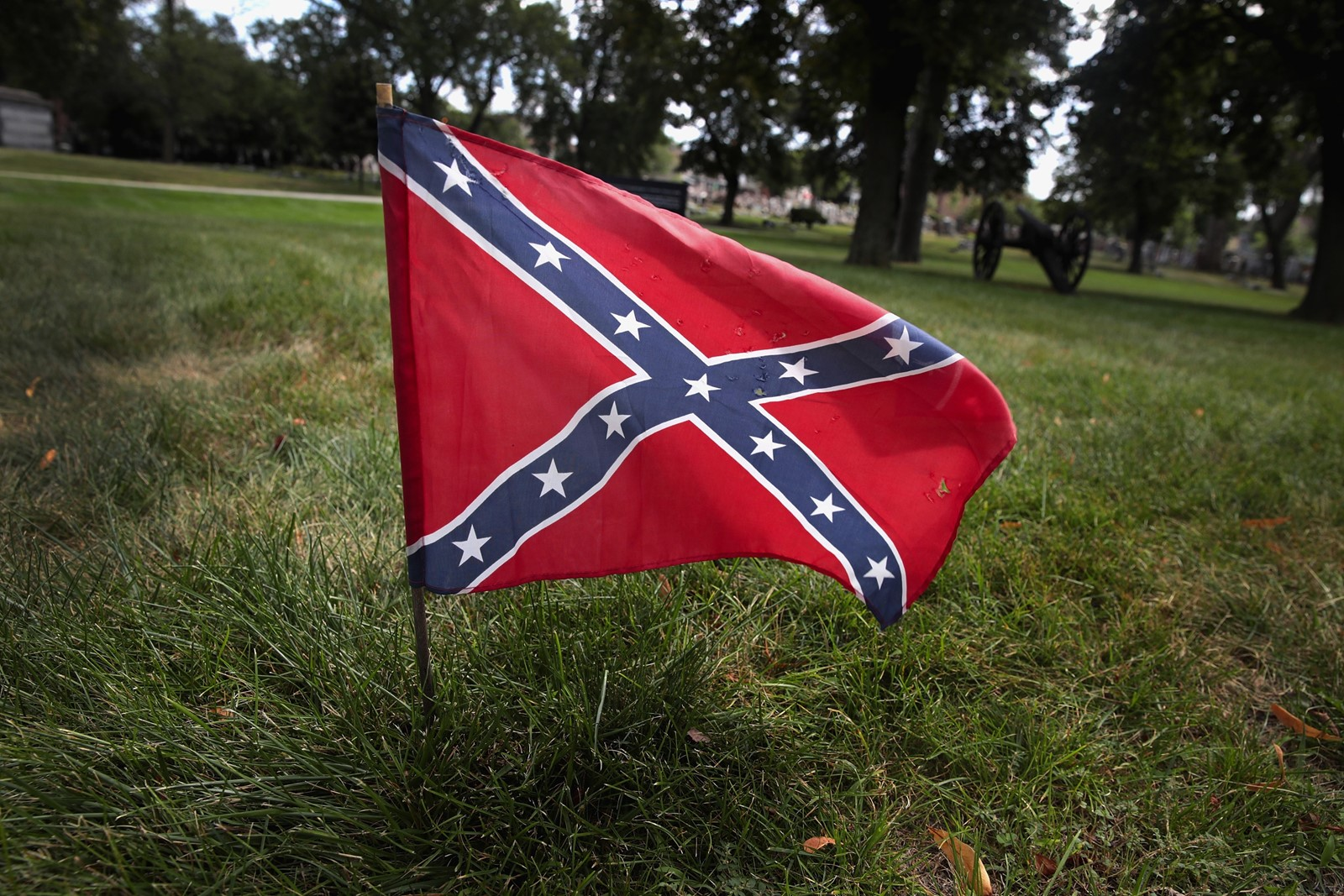 A confederate flag sits at the base of Confederate Mound at a private cemetery in Chicago. — Photograph: Scott Olson/Getty Images.