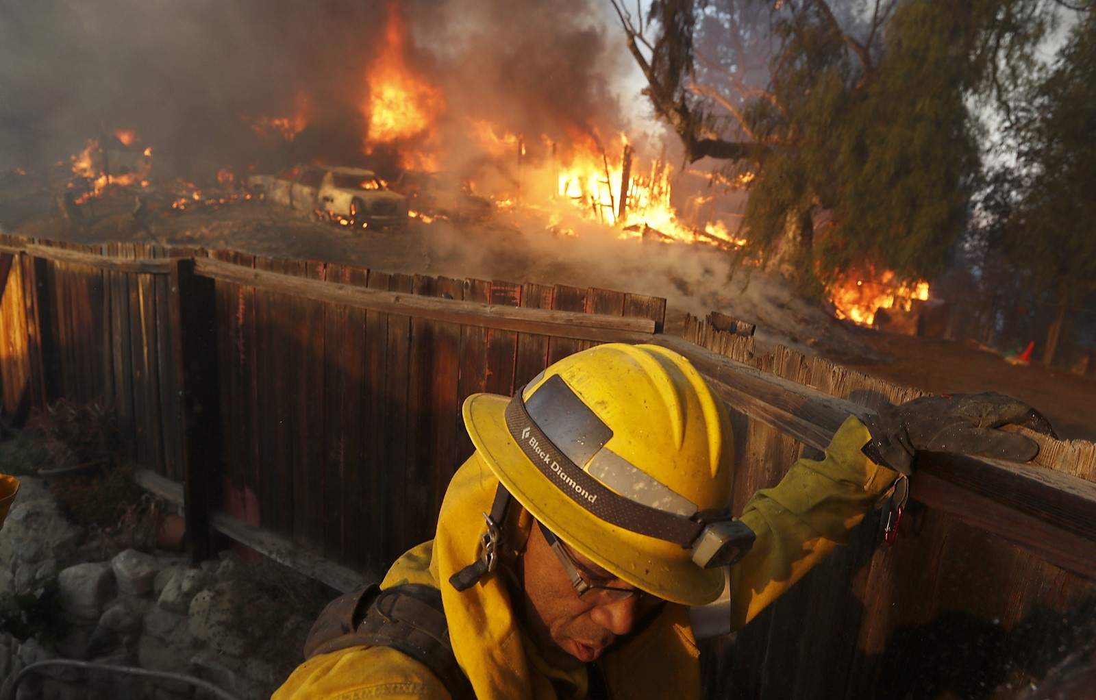 A firefighter monitors the Creek fire near Johanna Avenue and McBroom Street in Shadow Hills. The blaze scorched 11,000 acres and burned 30 homes. — Photograph: Luis Sinco/Los Angeles Times.