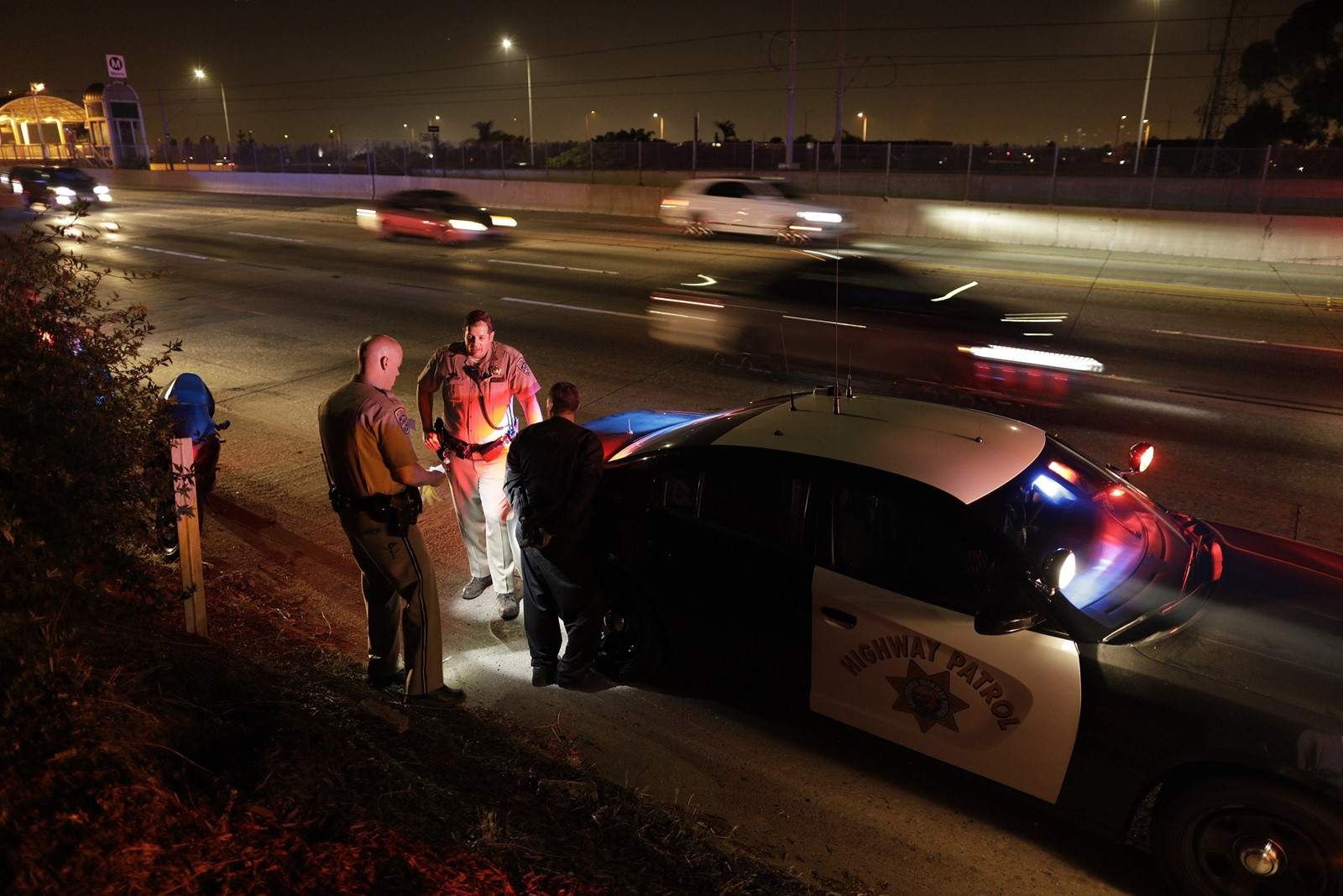 California Highway Patrol officers arrest a motorcyclist who had led them on a freeway pursuit. A recent CHP task force targeted illegal street racers. — Photograph: Myung J. Chun/Los Angeles Times.