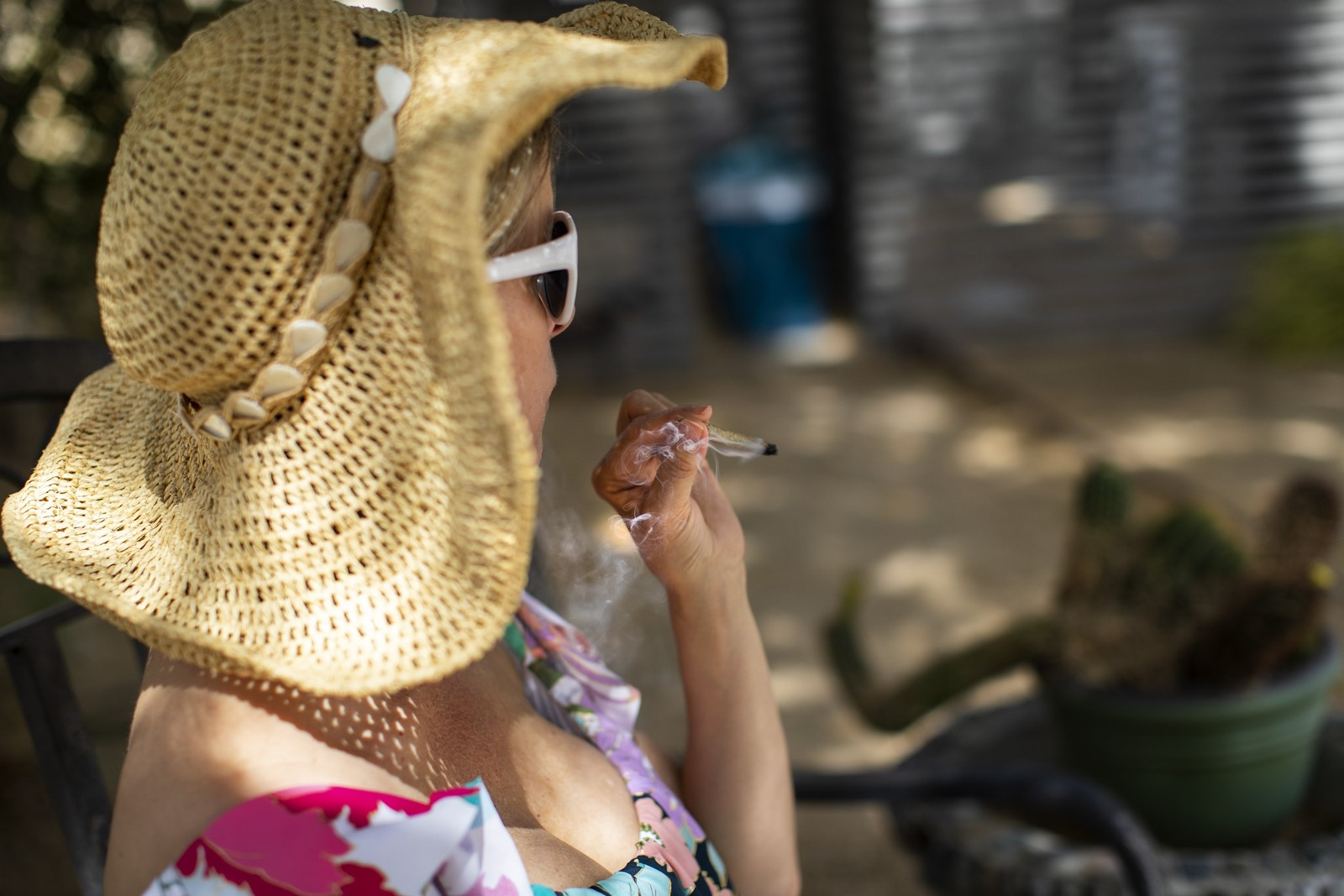 Chevyn McClintock puffs on a joint. Business at the inn has improved since it began courting pot users. — Photograph: Gina Ferazzi/Los Angeles Times.