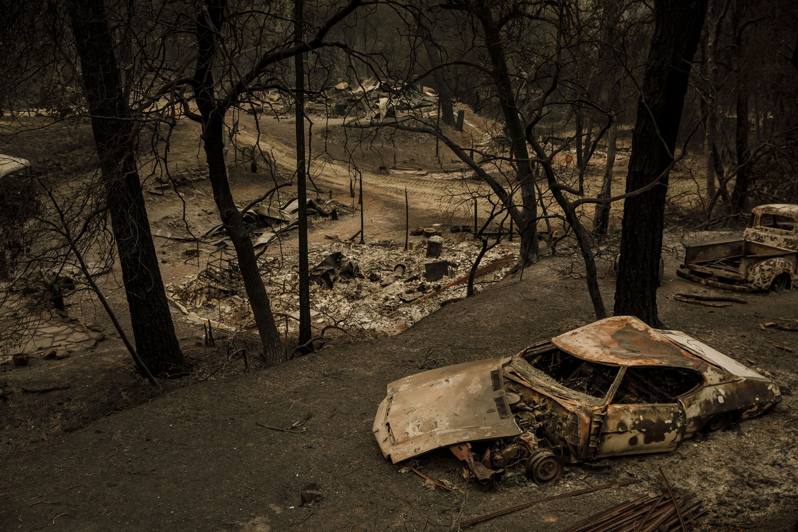 "The wildfire swept through and destroyed property and structures on Saturday in Shasta. ""We are doing everything in our power to bring an end to this chaos,"" Shasta County Fire Chief Mike Hebrard said. — Photograph: Marcus Yam/Los Angeles Times."