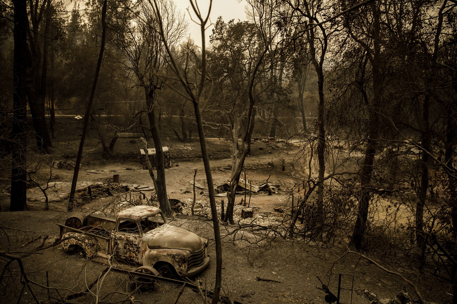 Scorched earth remains after the Carr fire swept through Shasta, California. Six people have died in the blaze, including four civilians. — Photograph: Marcus Yam/Los Angeles Times.