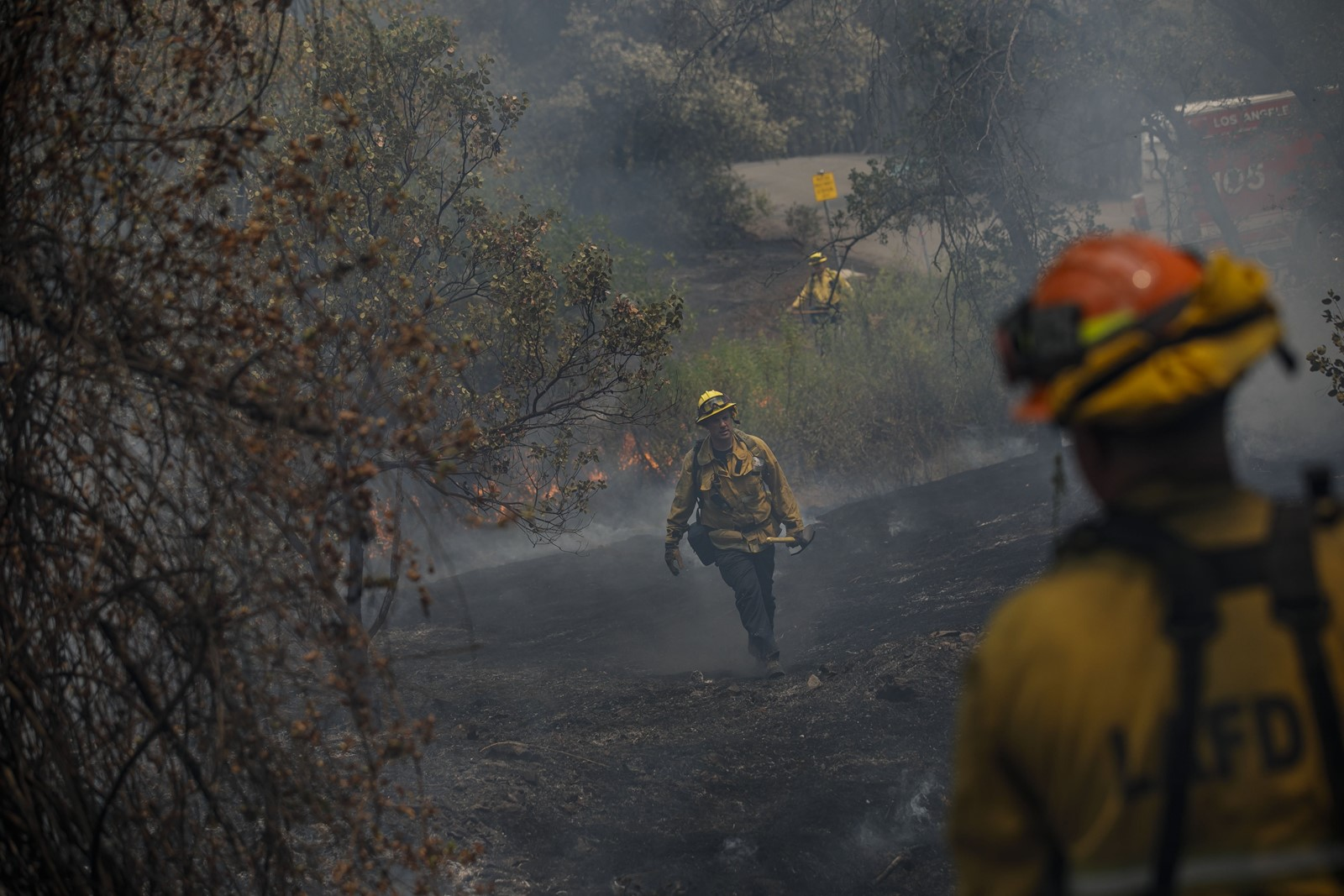 Los Angeles firefighters battle the Carr fire near Redding on Sunday. The blaze has burned more than 95,000 acres, destroyed 874 structures and killed eight people. — Photograph: Marcus Yam/Los Angeles Times.