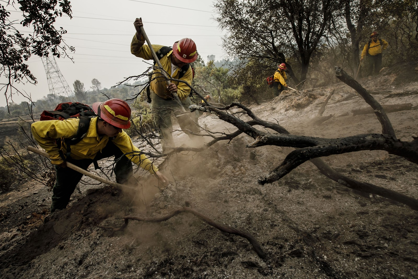 Firefighters from S&R Contracting in Oregon perform mop-up work on Monday near Redding, California. — Photograph: Marcus Yam/Los Angeles Times.