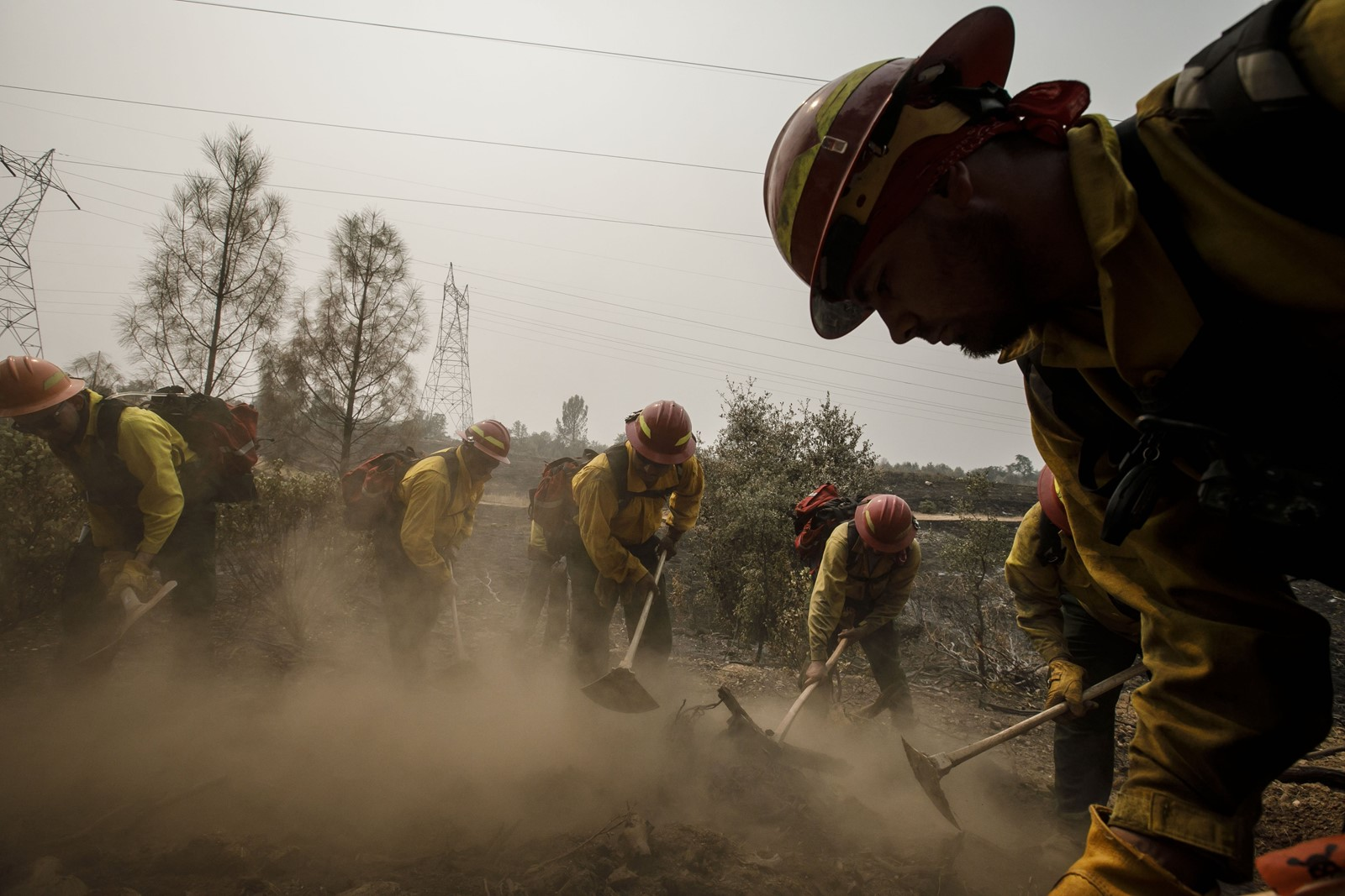 Firefighters from Oregon mop up hot spots on the Carr fire near Redding, California, where 3,600 firefighters gathered to take on the deadly blaze. — Photograph: Marcus Yam/Los Angeles Times.