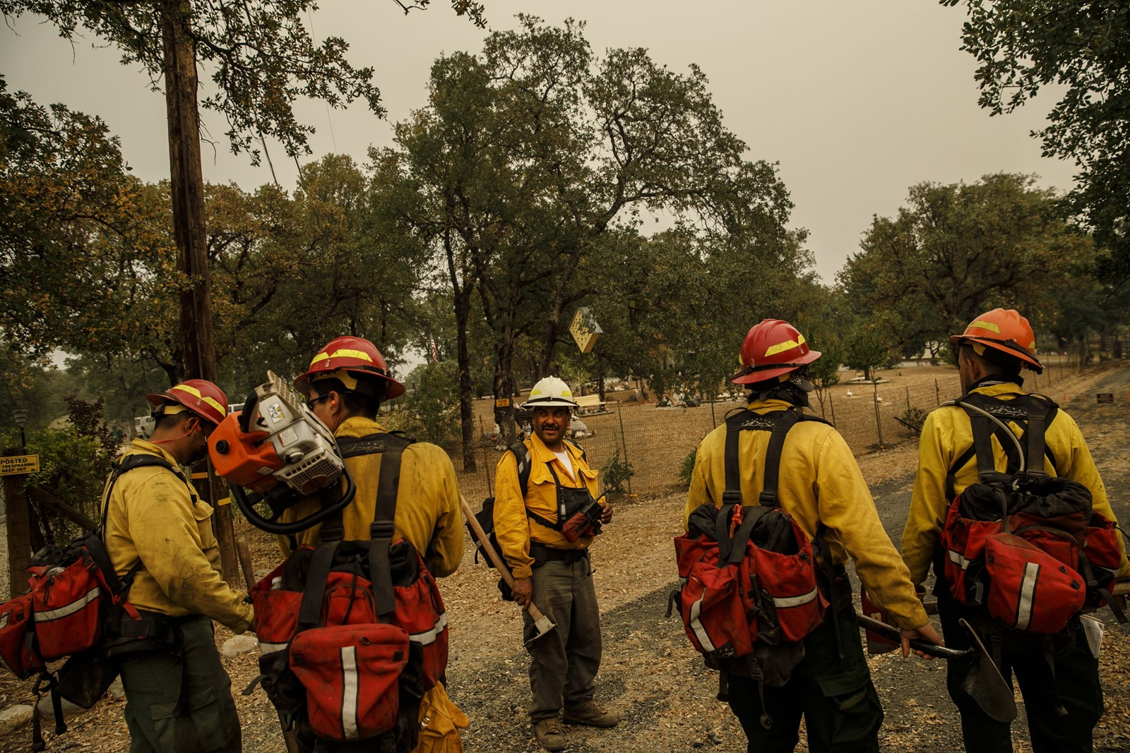 "Federico Rocha Sr., center, oversees a crew mopping up hot spots near Redding, California. ""I'd say for the last 15 years, the Hispanic population started to get more involved"" in firefighting, says Rocha, a Mexican immigrant. — Photograph: Marcus Yam/Los Angeles Times."