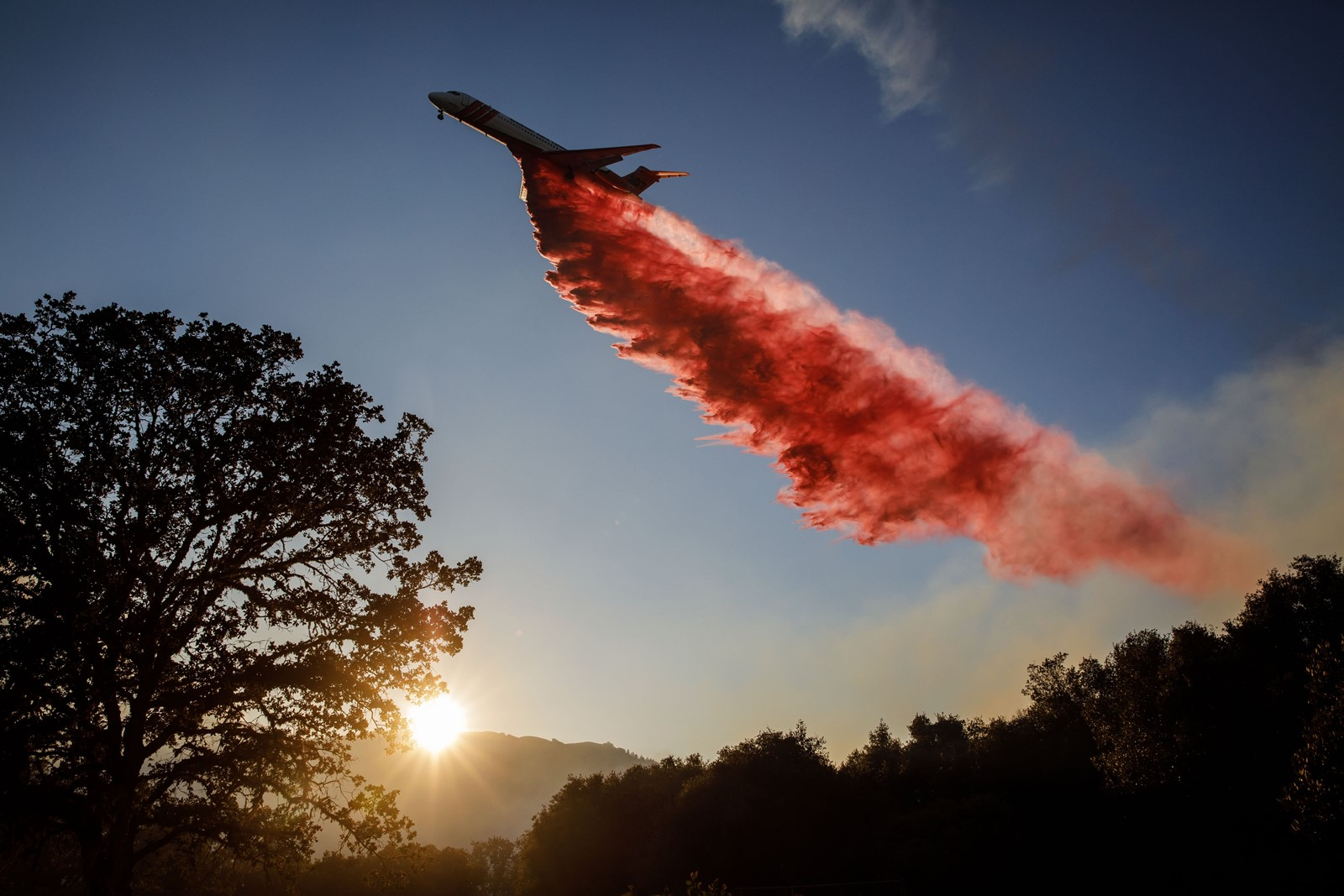An air tanker drops fire retardant ahead of the River fire in Mendocino County, California on Wednesday. — Photograph: Marcus Yam/Los Angeles Times.