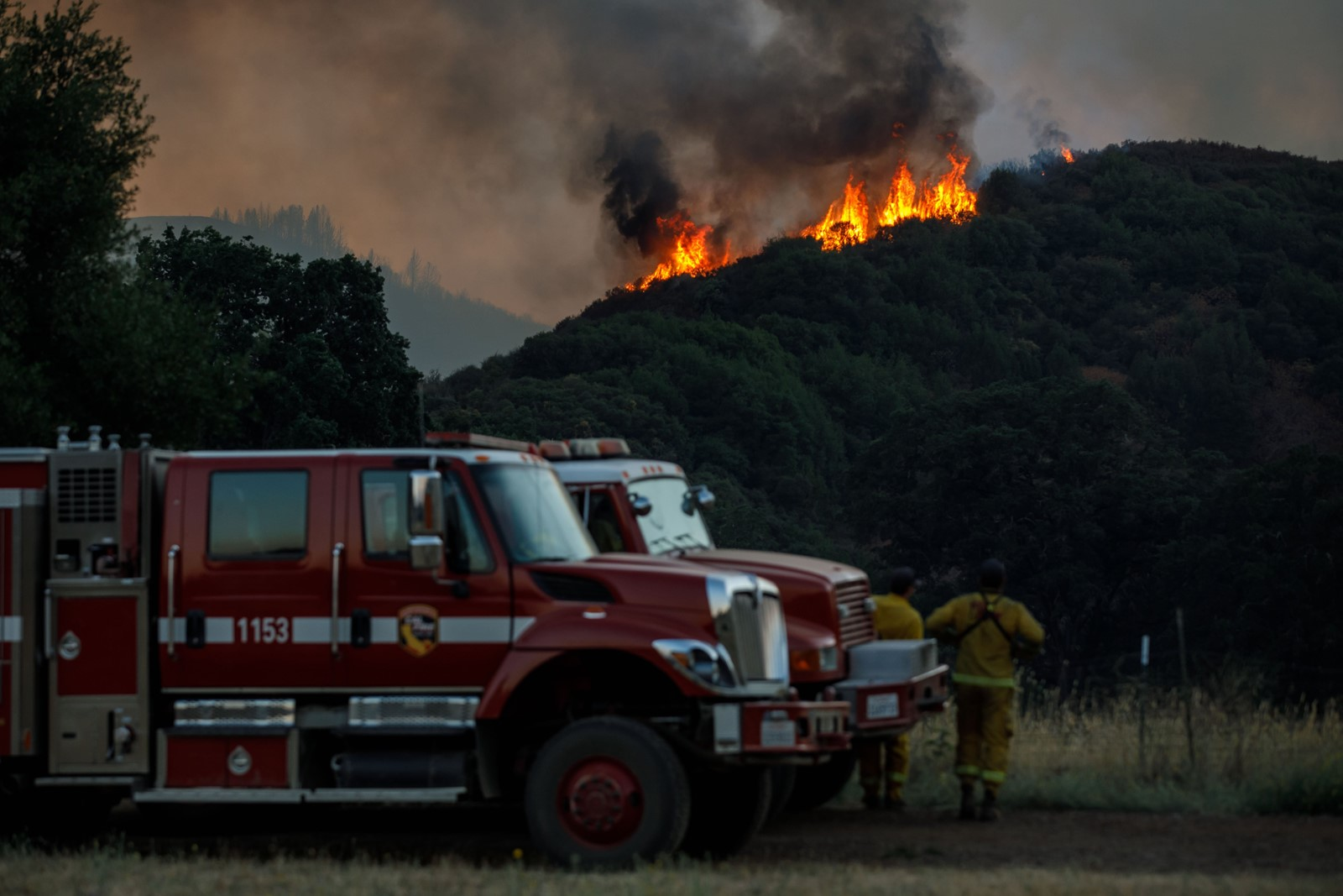 Firefighters monitor the progression of the River fire on Wednesday. Low humidity, heat and wind challenged crews, although containment increased on the southern Mendocino County blaze and another nearby. — Photograph: Marcus Yam/Los Angeles Times.