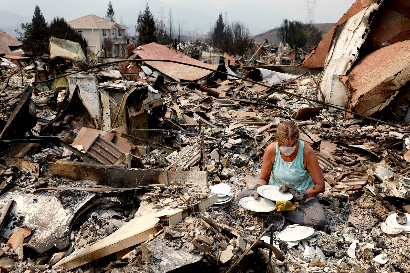 Maureen Kissick in Redding, California looks through what is left of her china from her wedding 36 years ago. — Photograph: Gary Coronado/Los Angeles Times.