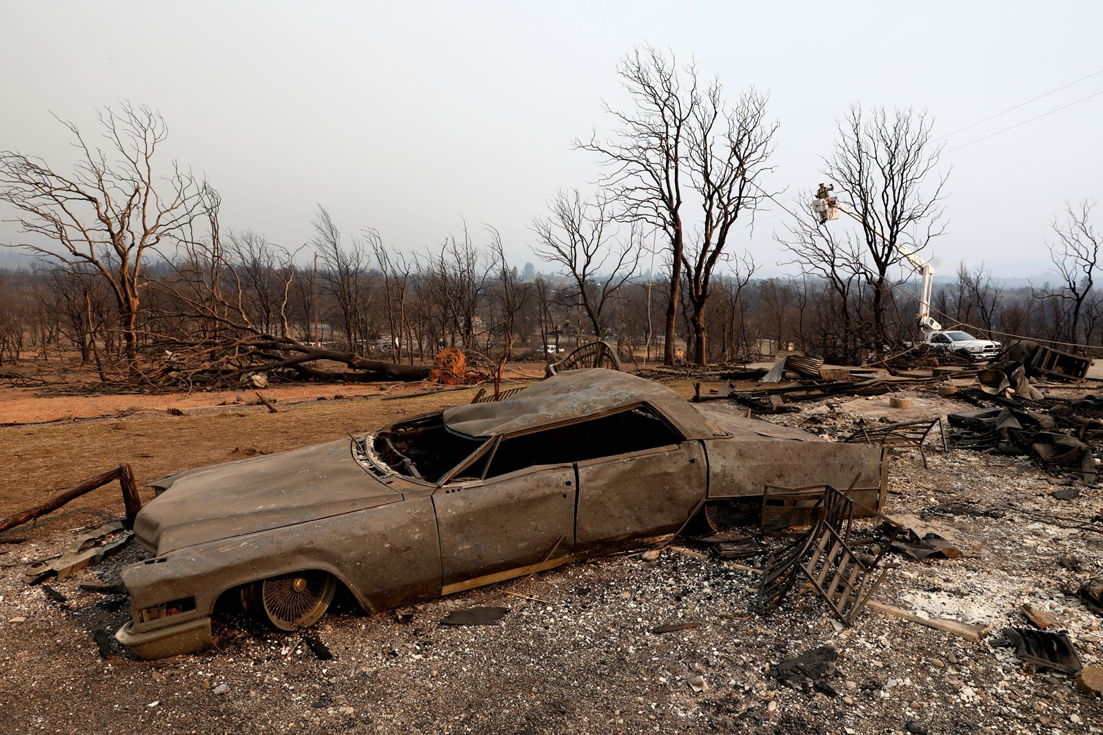 Record-setting temperatures have contributed to destructive wildfires across California. Above, a Redding home and vehicle destroyed by the Carr fire. — Photograph: Gary Coronado/Los Angeles Times.