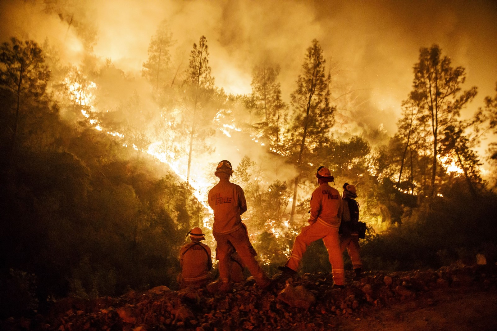 Firefighters monitor a burn operation near Lodoga in the battle against the Mendocino Complex fire. Its remote location, in rugged, forested terrain where no fire engine can reach, is a big reason it rapidly grew into the largest in California history. — Photograph: Marcus Yam/Los Angeles Times.