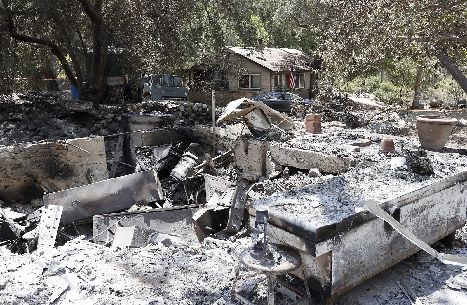 The home of a man suspected of arson stands intact amid burned-out houses in Trabuco Canyon. — Photograph: Luis Sinco/Los Angeles Times.