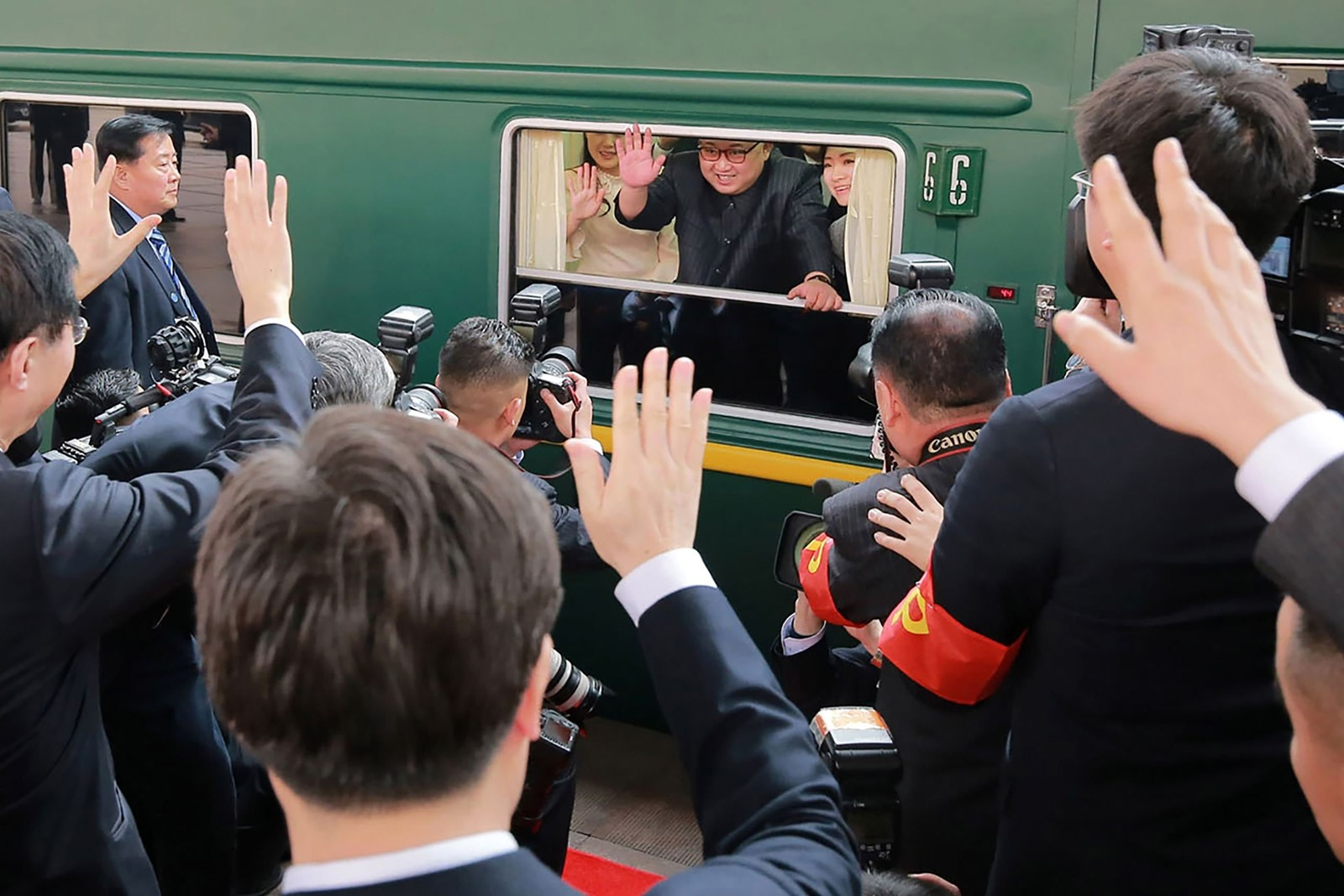 North Korean leader Kim Jong Un bids farewell from his armored train as it prepares to leave Beijing. — Photograph: Korean Central News Agency.