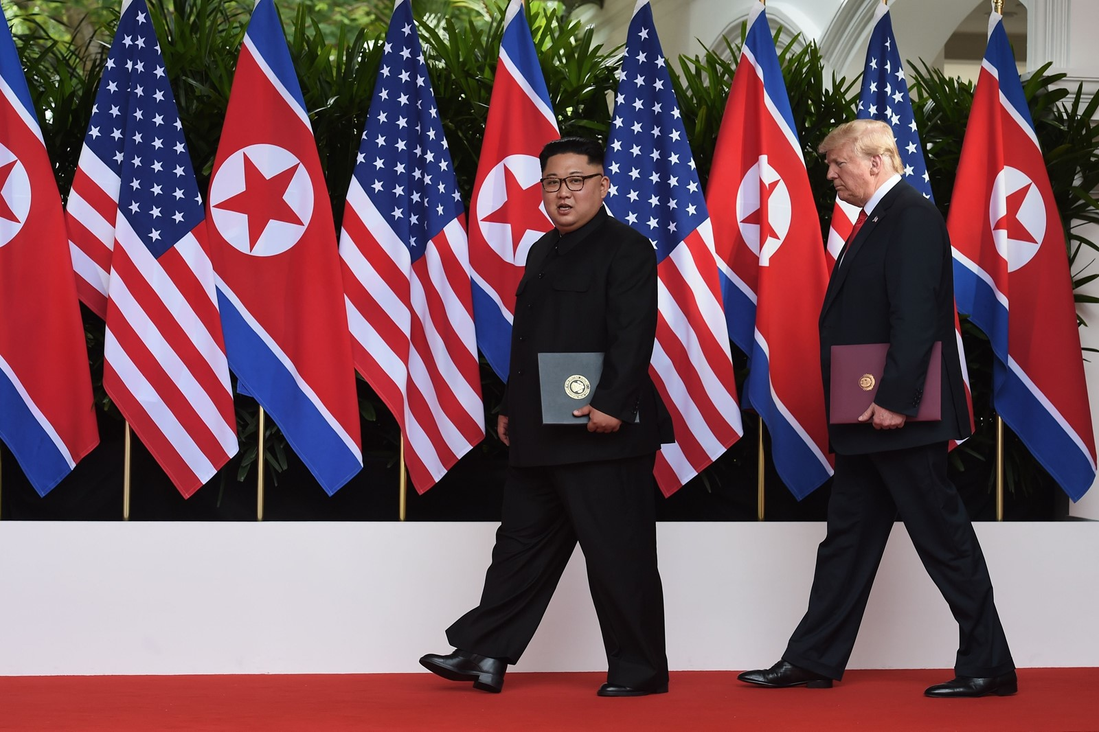 After a summit with North Korea's Kim Jong Un, President Donald J. Trump halted military drills with South Korea. — Photograph: Anthony Wallace/Pool Photo.