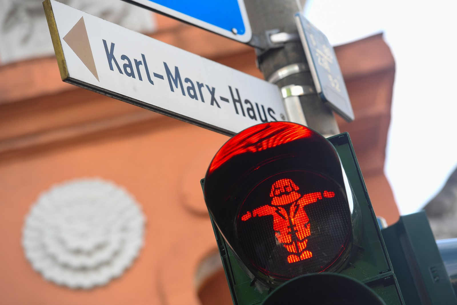 Marx-like green and red figures on traffic lights for pedestrian crossings are part of the Marx mania in Trier, the philosopher's west German hometown. — Photograph: Patrik Stollarz/Agence France-Presse/Getty Images.