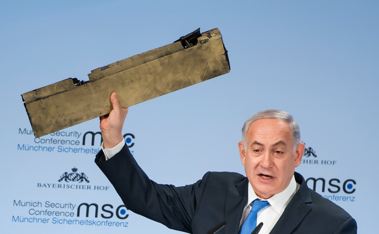 In Munich, Netanyahu holds what he said was part of an Iranian drone shot down in Israeli airspace. — Photograph: Lennart Preiss/Agence France-Presse/Getty Images.