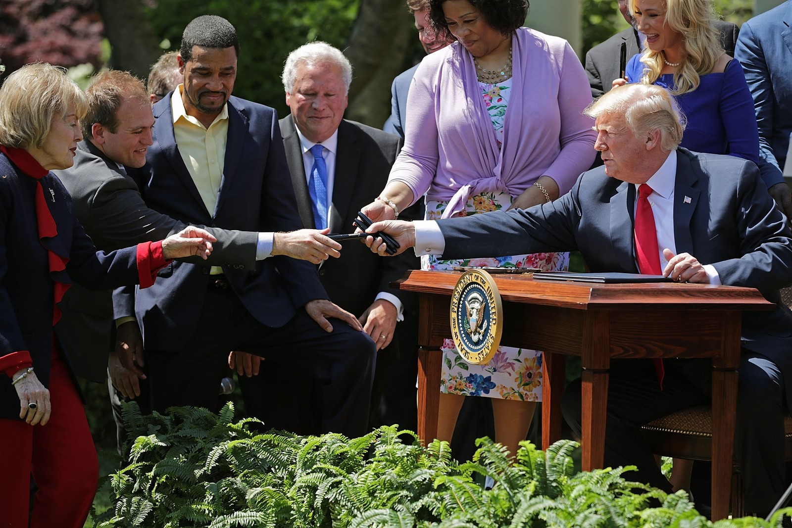 President Donald J. Trump turned his attention from the scandal to the National Day of Prayer, inviting faith leaders to his Rose Garden signing of an executive order creating a White House advisor on religious liberty. — Photograph: Chip Somodevilla/Getty Images.