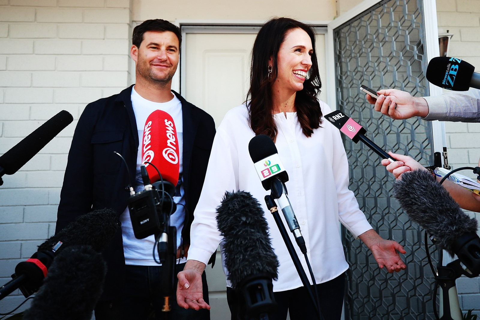 New Zealand Prime Minister Jacinda Ardern, 37, is the world's youngest female leader. At left is her life partner, television host Clarke Gayford. — Photograph: Hannah Peters/Getty Images.