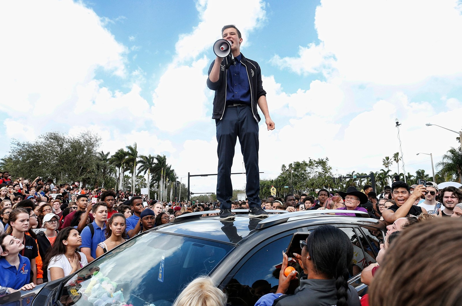 Cameron Kasky, a survivor of the shooting at Marjory Stoneman, speaks to other students at a rally on Wednesday in Parkland, Florida. — Photograph: Rhona Wise/Agence France-Presse/Getty Images.