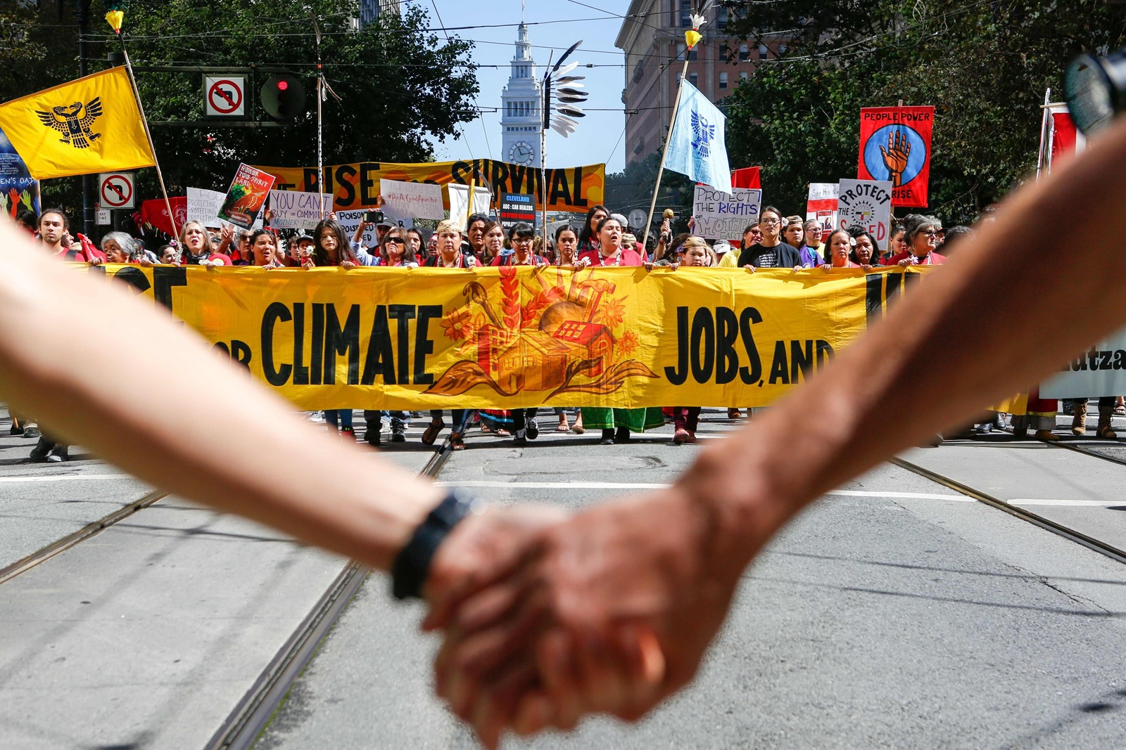 Climate change activists march in San Francisco last week. Climate thinkers, celebrities and political leaders will gather in the city this week. — Photograph: Amy Osborne/Agence France-Presse/Getty Images.