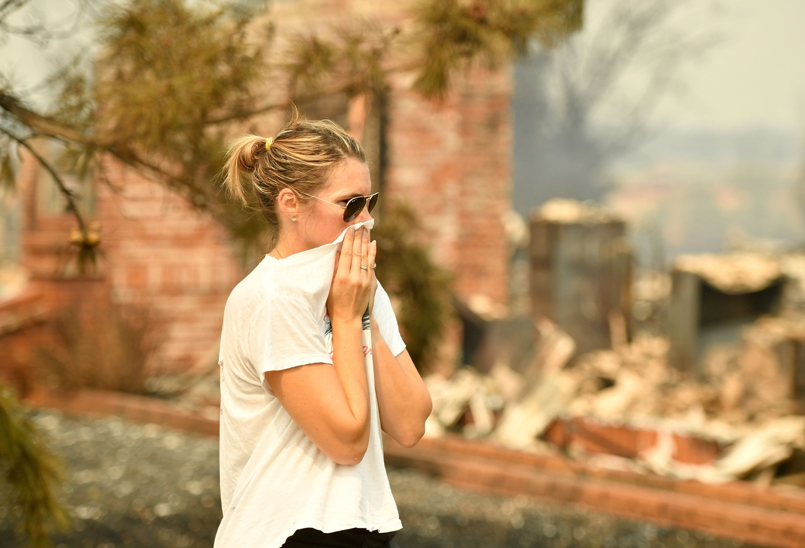 A woman sees her grandmother's burned home among the dozens destroyed in the Carr fire. — Photograph: Josh Edelson/Agence France-Presse/Getty Images.
