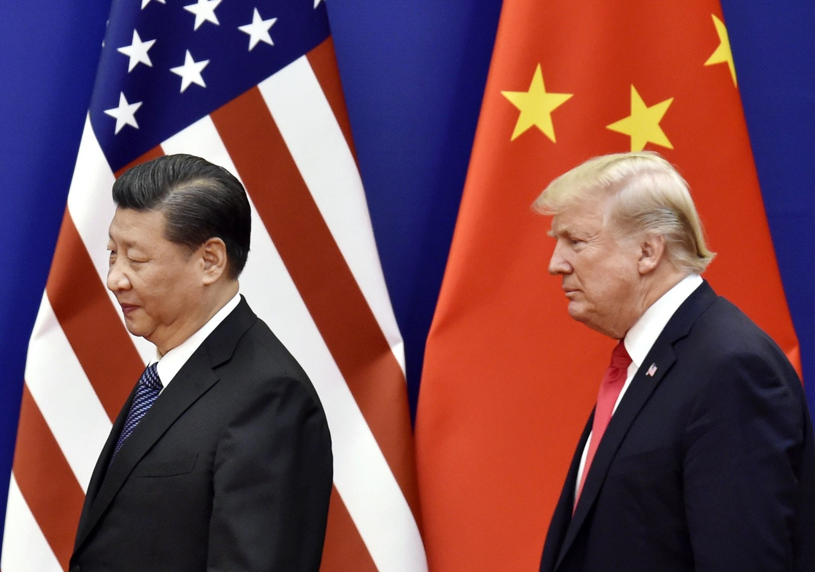 Presidents Xi Jinping and Donald J. Trump at their summit in Beijing last November. The U.S.-China relationship since then has deteriorated quickly and significantly. — Photograph: Kyodo.