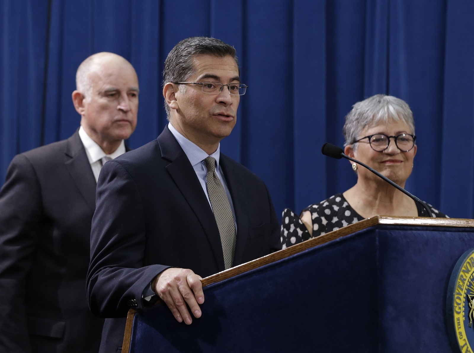State Attorney General Xavier Becerra, center, has won 12 key rulings in the lawsuits he has filed against the U.S. federal administration of Donald J. Trump. — Photograph: Rich Pedroncelli/Associated Press.