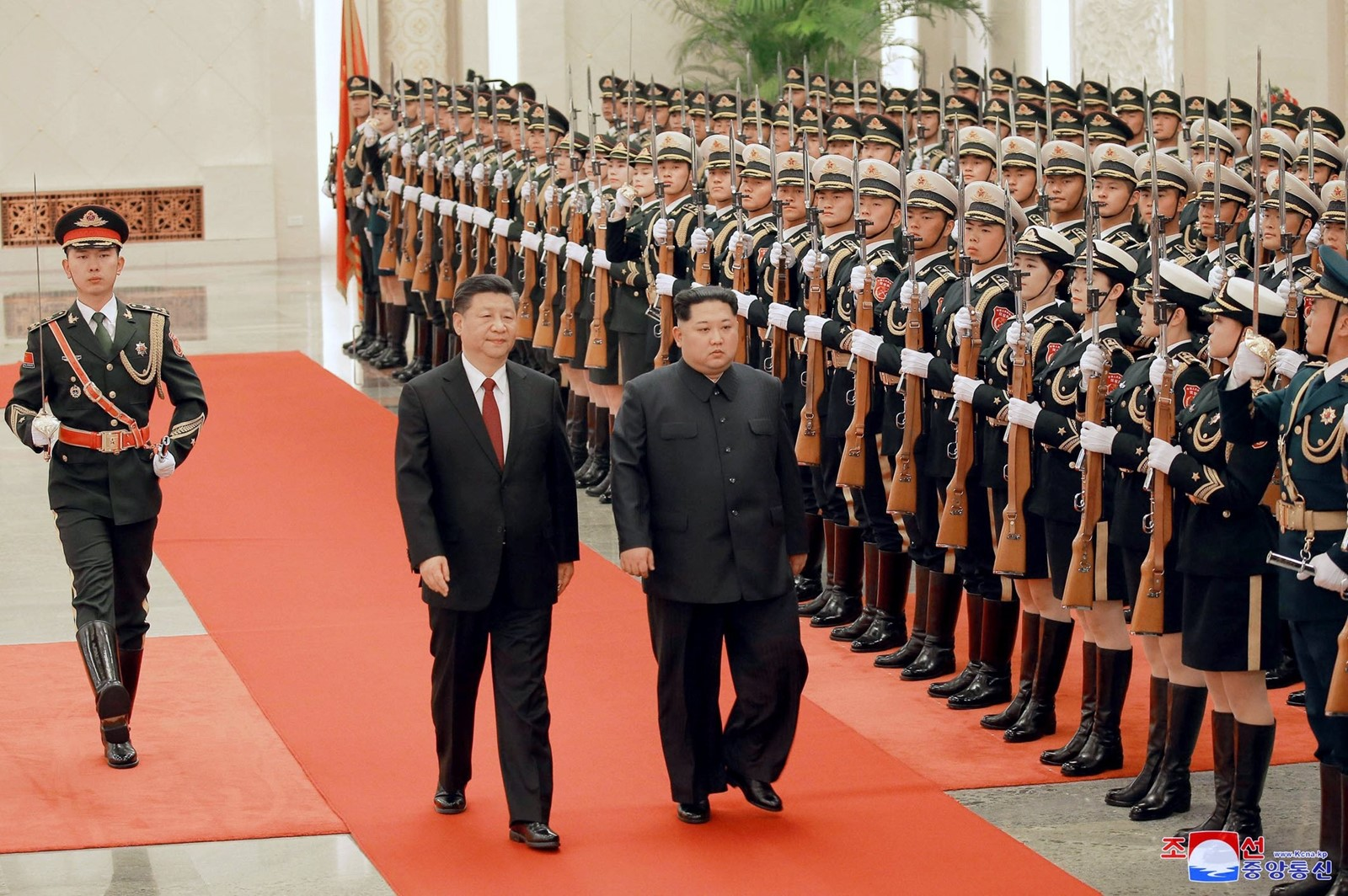 Chinese President Xi Jinping, left, and North Korean leader Kim Jong Un inspect an honor guard in Beijing on Monday. The leaders may have used their meeting to strategize about North Korea's upcoming talks. — Photograph: Korean Central News Agency.