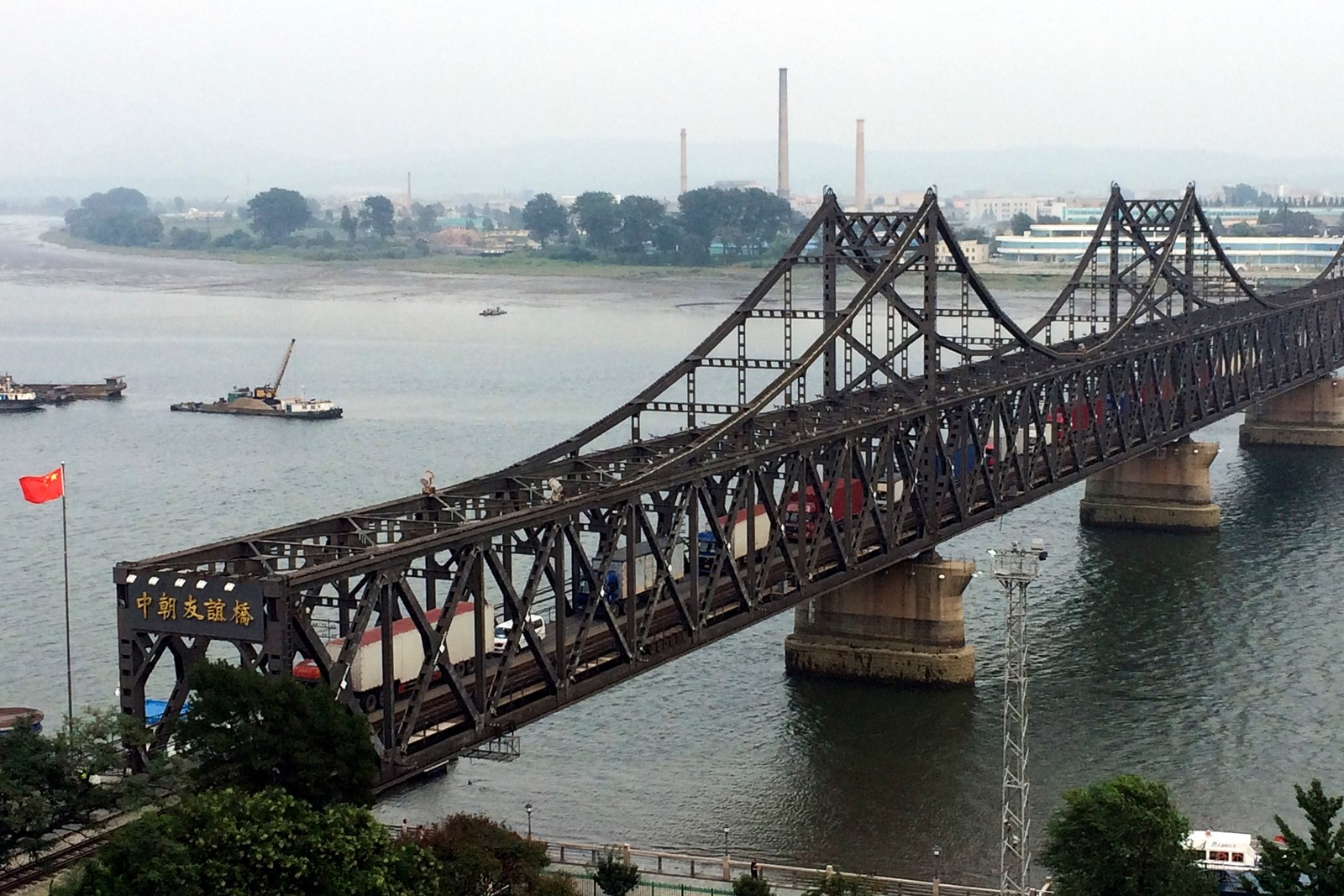 The Friendship Bridge in Dandong connecting China and North Korea has reportedly seen an increase in trucks, and a decrease in customs inspections. — Photograph: Helene Franchineau/Associated Press.