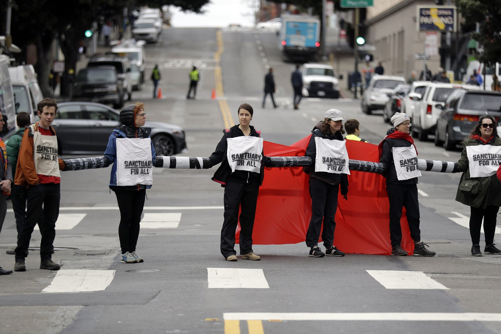 Mayor Libby Schaaf says the immigration raid was aimed not at hardened criminals but at upstanding residents. But some fear her public warning may lead to federal payback. Above, protesters in San Francisco. — Photograph: Marcio Jose Sanchez/Associated Press.