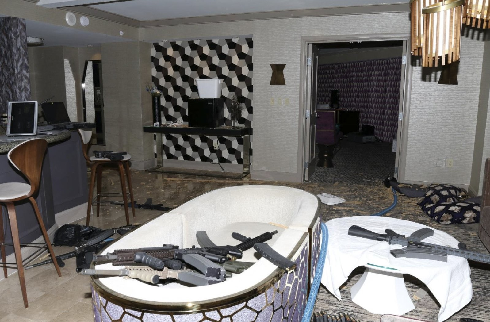 This photo of Stephen Paddock's Mandalay Bay hotel room shows some of the 23 weapons police found after the October 1st shooting, which left 58 people dead. — Photograph: Las Vegas Metropolitan Police Department.
