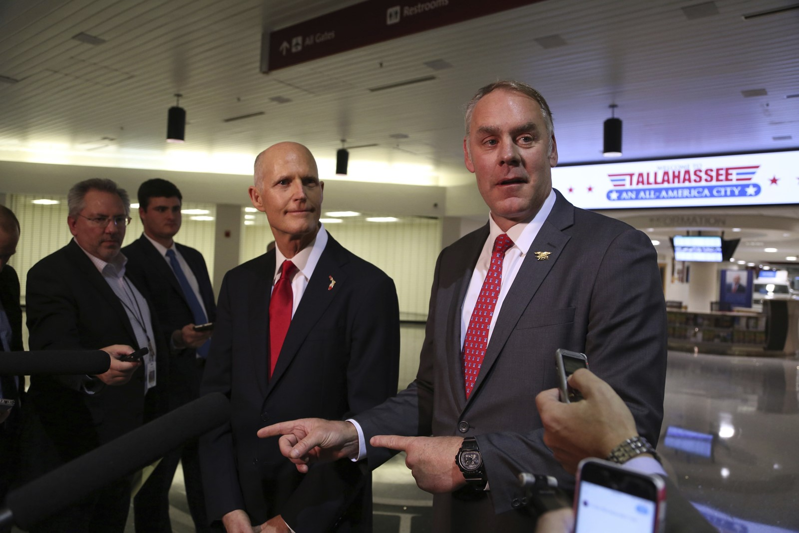 Interior Secretary Ryan Zinke, right, holds a news conference in Tallahassee, Florida, with Republican Governor Rick Scott to announce that the offshore oil drilling plan unveiled last week won't include Florida. — Photograph: Scott Keeler/Tampa Bay Times.
