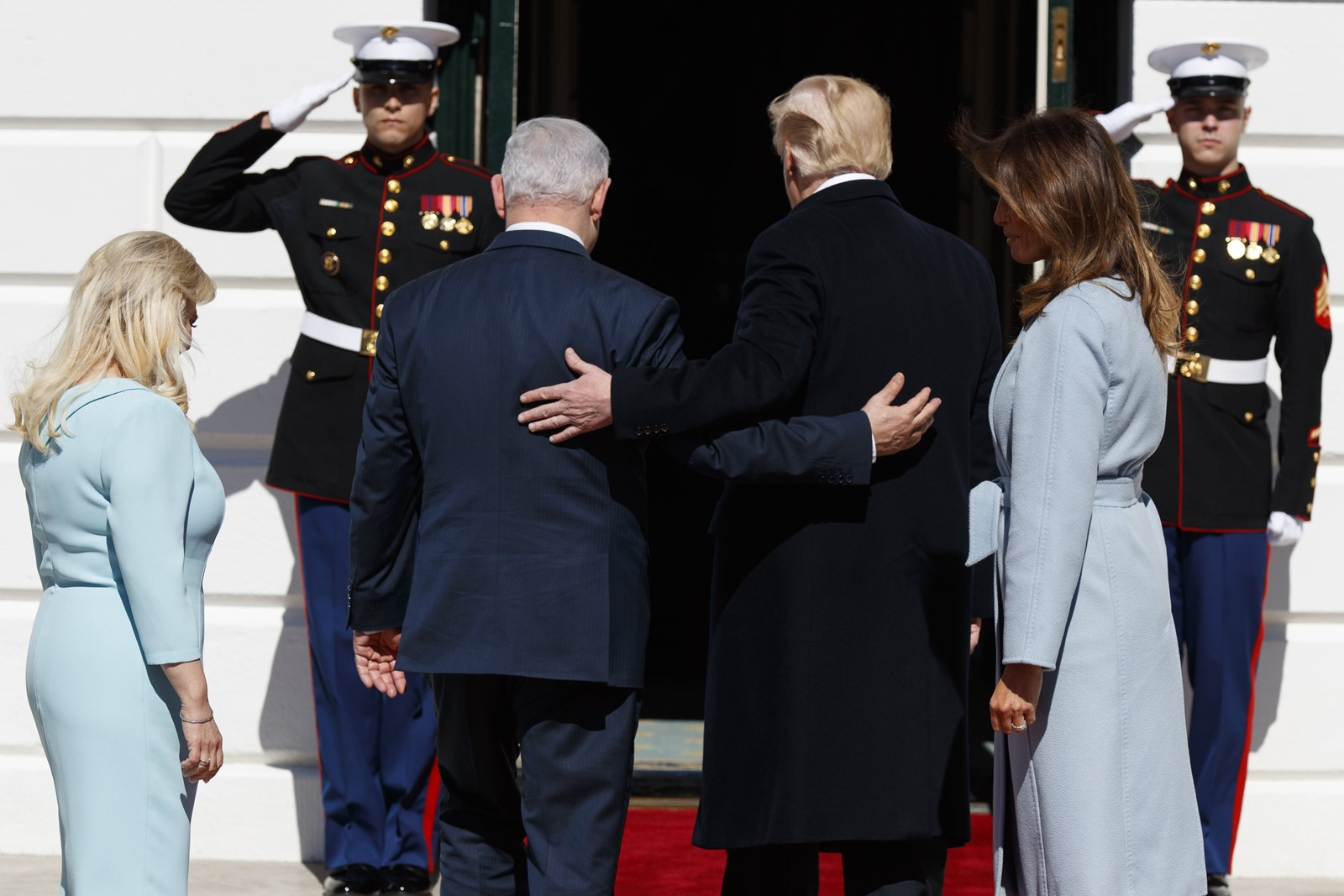 Israeli Prime Minister Benjamin Netanyahu and President Donald J. Trump with Sara Netanyahu, far left, and Melania Trump. Both men could get a political boost from the visit, at least with their political bases. — Photograph: Evan Vucci/Associated Press.