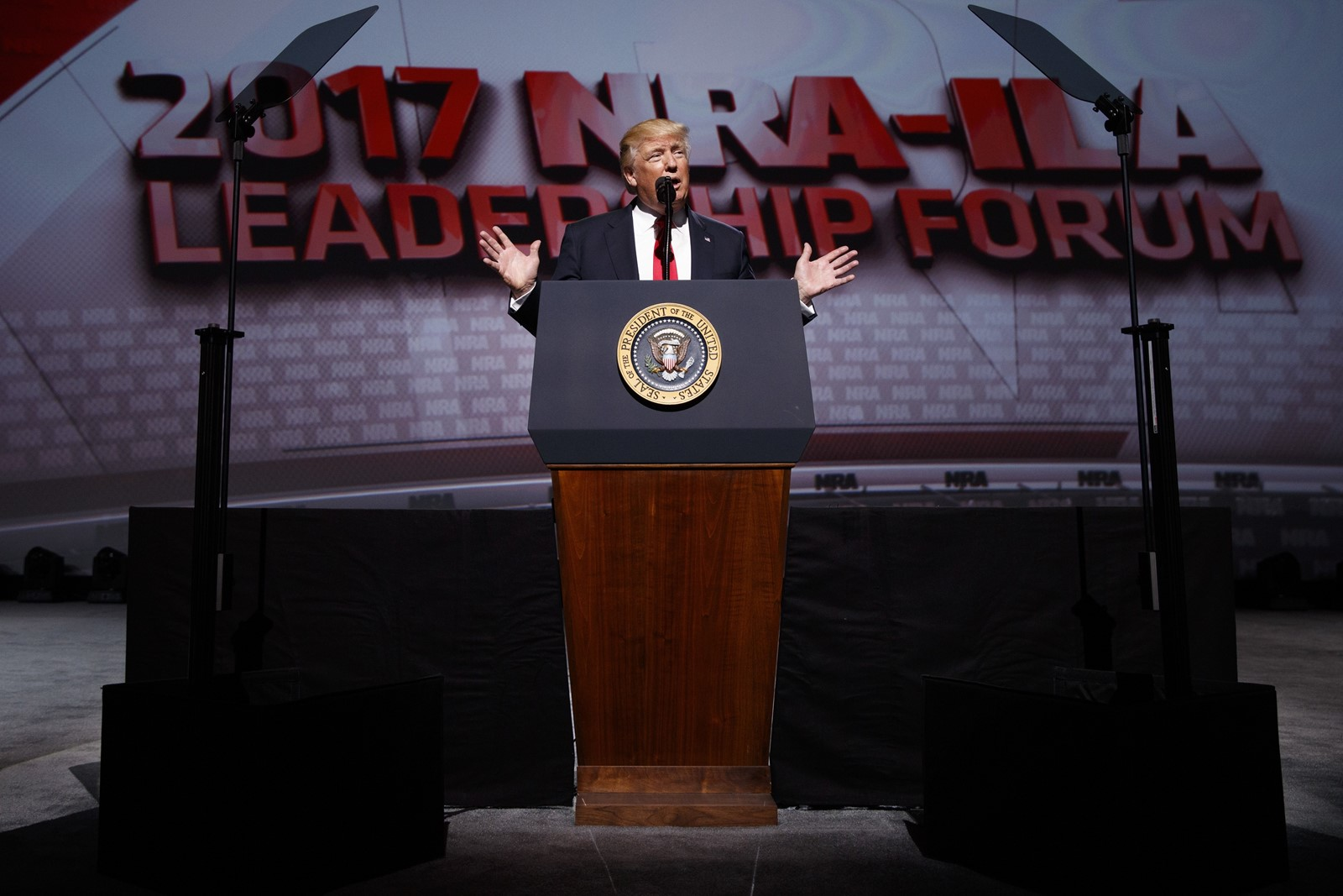President Donald J. Trump addresses the National Rifle Association's leadership conference in Atlanta last year. — Photograph: Evan Vucci/Associated Press.