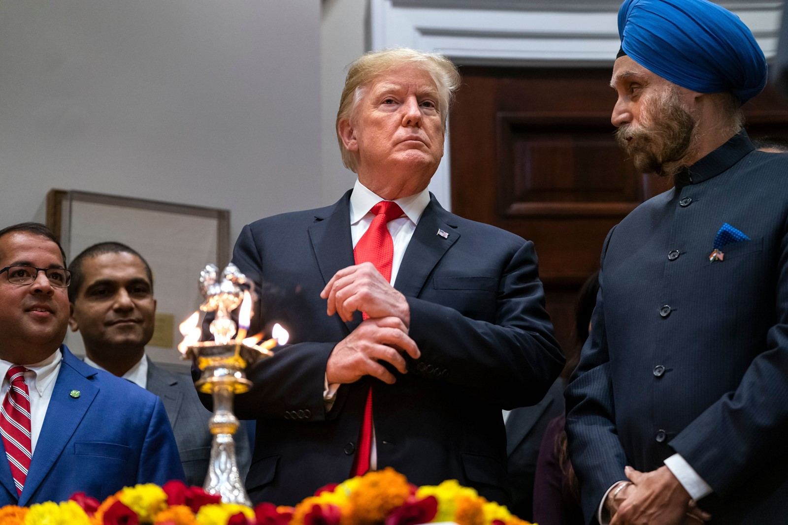 President Donald J. Trump spoke briefly but did not respond to reporters' shouted questions at his only public appearance on Tuesday, at a short White House ceremony for the start of Diwali, the Hindu festival of lights. — Photograph: Jim Lo Scalzo/European Pressphoto Agency/Shutterstock.