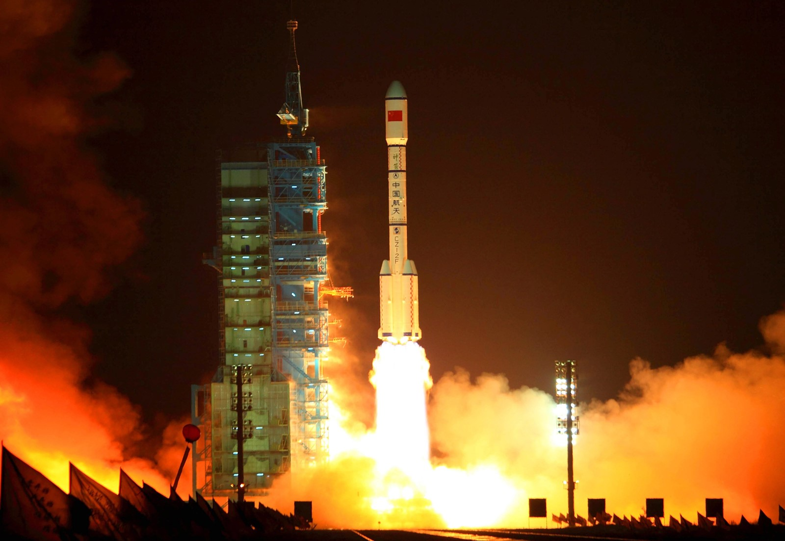 "A rocket carrying the Tiangong-1 space station blasts off from the Jiuquan launch center in China's north-central province of Gansu in September 2011. The space station's name means ""heavenly palace"". — Photograph: Agence France-Presse/Getty Images."