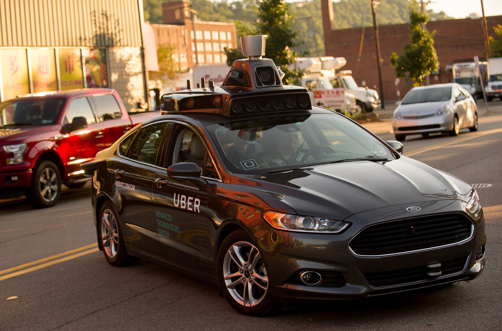 An Uber Ford Fusion driverless sedan travels through Pittsburgh in 2016. Critics assert that today's artificial intelligence simply cannot deliver self-driving vehicles as originally envisioned by researchers. — Photograph: Jeff Swensen/Getty Images.