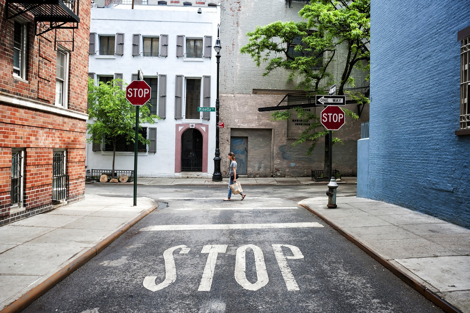 "Over time, cities will probably adopt ""geo-fencing"" — a fancy term for creating separate zones and designated pickup spots for self-driving cars. But until then, pedestrians' unpredictable behavior poses a challenge. Without clues such as crosswalk markings and stoplights, the cars' software is less likely to identify jaywalkers. — Photograph: Dreamstime."