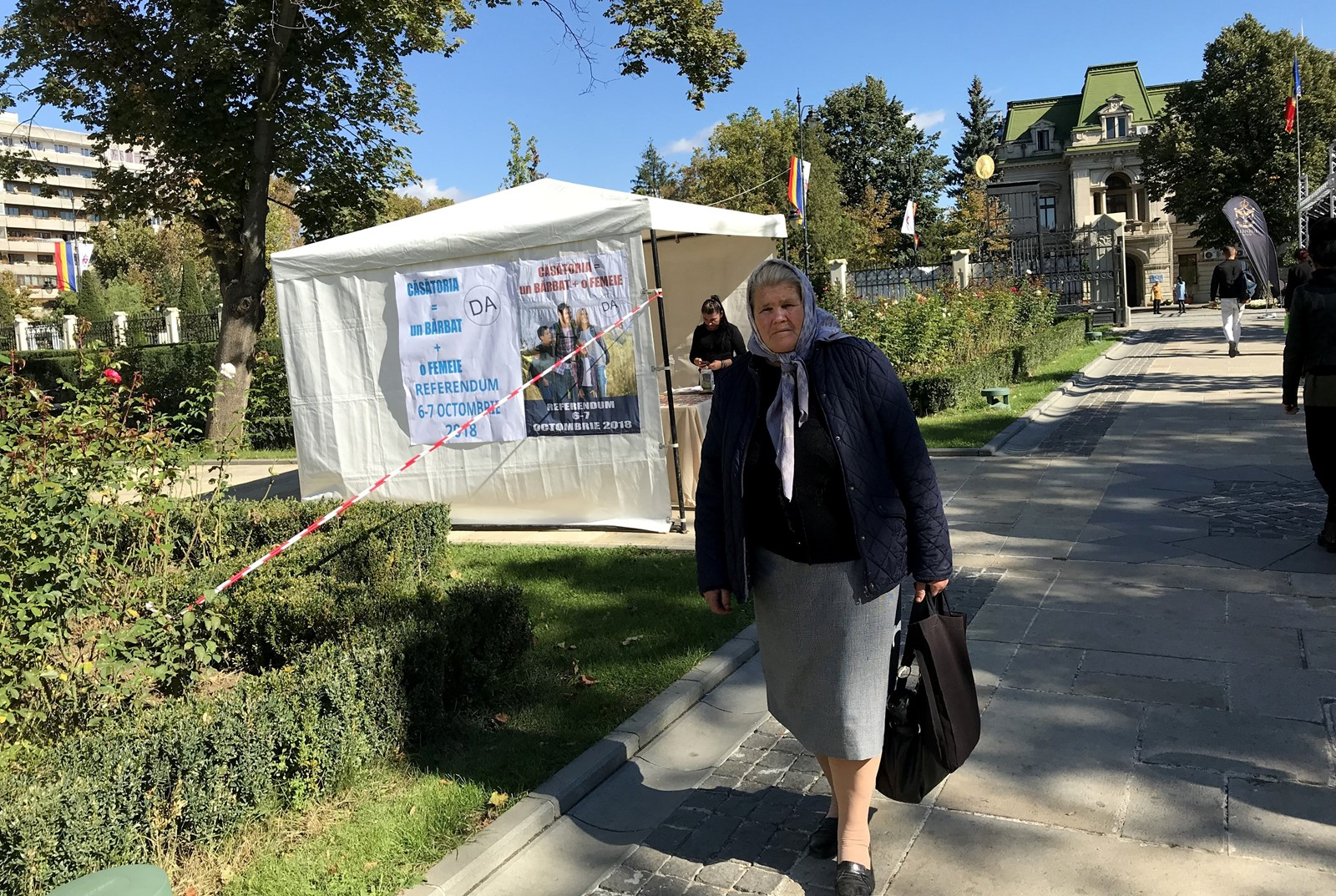 Romanians will vote this weekend on whether to change the constitution to ban same-sex marriage. Above, a woman in Iasi, Romania, walks past an information tent hosted by supporters of the referendum. — Photograph: Sabra Ayres/Los Angeles Times.