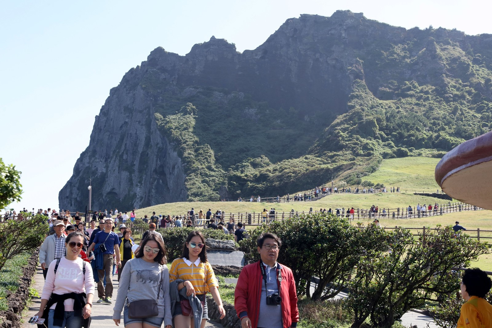 Tourists visit Jeju Island in October. After China ordered domestic travel agencies to stop selling package deals to South Korea, the island saw a huge drop in the number of Chinese visitors. China's retaliation also hurt South Korean merchants and automakers. — Photograph: Yonhap.