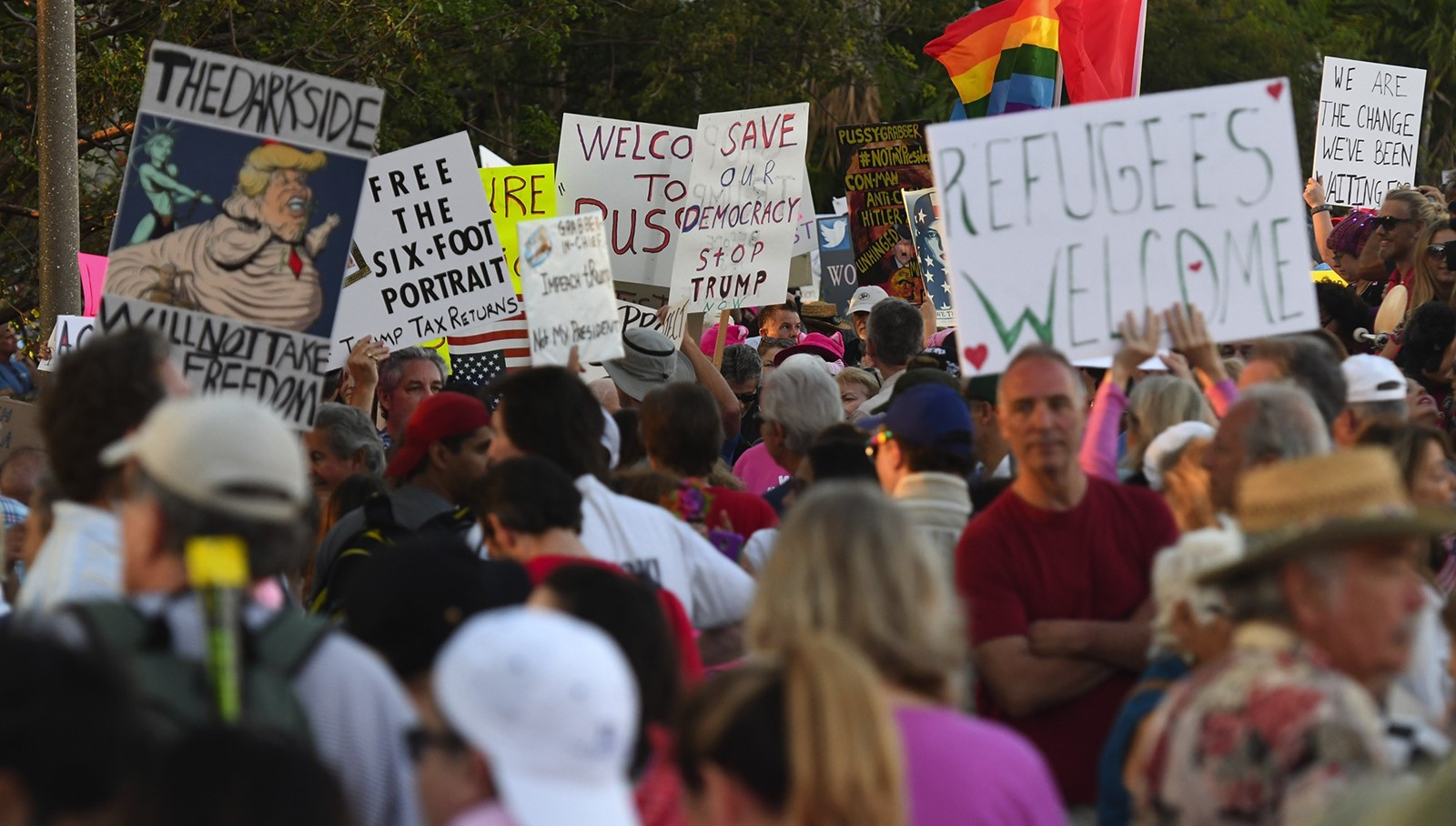 Protesters at Trump Plaza in West Palm Beach, Florida, in February. — Photograph: Jim Rassol/Sun-Sentinel.